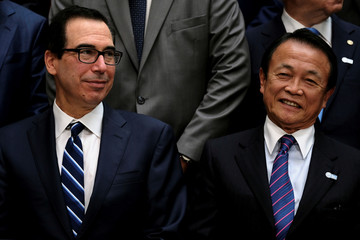 U.S. Treasury Secretary Steven Mnuchin and Japanese Finance Minister Taro Aso attend the IMF and World Bank's 2019 Annual Spring Meetings, in Washington