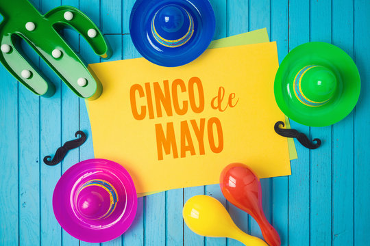 Cinco de Mayo holiday background with Mexican cactus and party sombrero hat on wooden board.