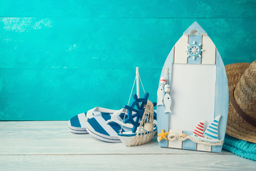 Summer holiday vacation concept with photo frame and nautical decorations on wooden table