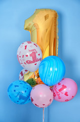 first birthday balloons and golden digit one 1