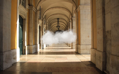 Arcade of a building with a floating cloud