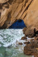 arch rock in a beach. Portugal Santa Cruz