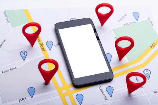 Map With Red Location Marker And Mobile Phone