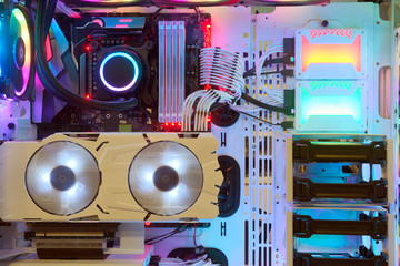 Close-up and inside Desktop PC Gaming and Cooling Fan CPU with multicolored LED RGB light show status on working mode, interior PC case technology background