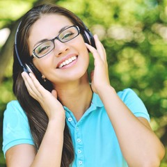 Beautiful young woman with headphones ejoying music