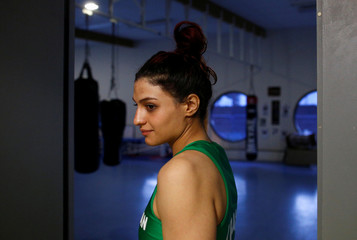 Iranian boxer Sadaf Khadem looks on before the fight against French boxer Anne Chauvin during an official boxing bout in Royan