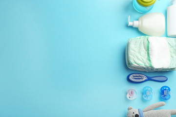 Flat lay composition with baby accessories and space for text on color background