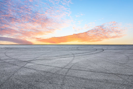 Asphalt race track ground and beautiful sky clouds at sunrise