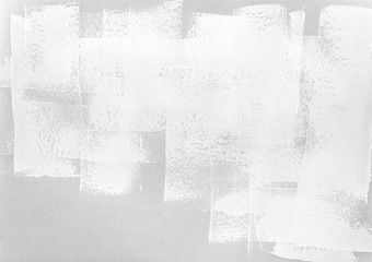 paint roller strokes on grey paper background. monochrome texture.