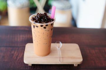 Ice bubble milk tea in takeaway glass.