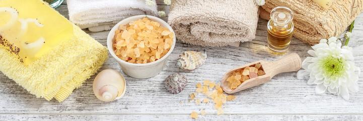 Spa set: soft towels, bar of soap and bowl of sea salt.