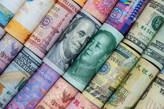 US dollar and China Yuan banknote  with multi countries banknotes. Its is symbol for tariff trade war crisis or unfair business of 2 biggest economic countries in the world.