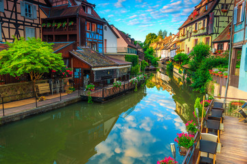 Stunning medieval colorful facades reflecting in water, Colmar, France, Europe