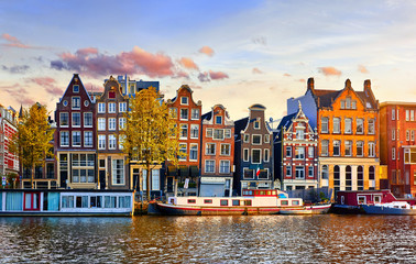 Poster Blue sky Amsterdam Netherlands dancing houses over river Amstel landmark in old european city spring landscape.
