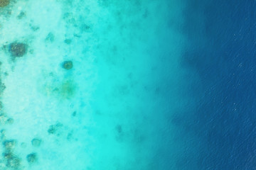 Foto auf Acrylglas Reef grun Ocean as a background from top view. Turquoise water background from top view. Summer seascape from air. Gili Meno island, Indonesia. Travel - image
