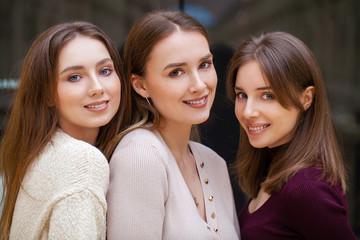 Wall Mural - Three brunette young women, indoor