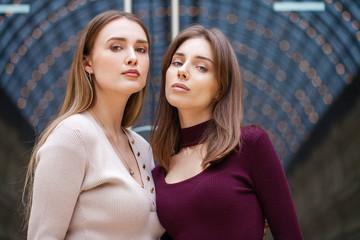 Wall Mural - Two brunette young women, indoor