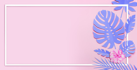 Wall Mural - Purple tropical leaves layout. White frame at paper tropical leaves with flowers on pink background. Creative composing in pastel color with copy space for your design