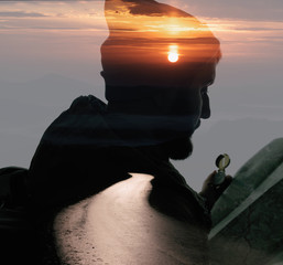 Double exposure with bearded traveler and mountain dawn. Metaphor of travel.
