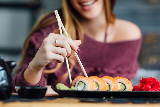 Weekend breakfast. woman feeling rested enjoying weekend breakfast sushi .