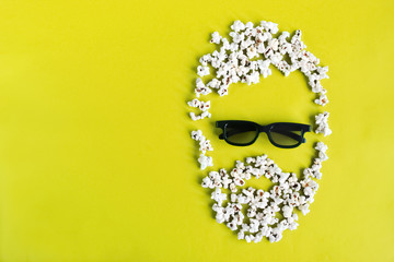 Abstract image of man viewer, 3D glasses, popcorn. Cinema time on blue paper background. Concept cinema movie and entertainment. Top down composition copy space