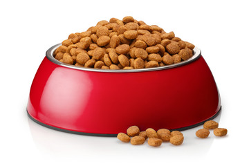 Dry cat food in a red bowl, isolated on white background Wall mural