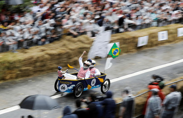 Competitors ride a home-made vehicle on a downhill track during the Red Bull Soapbox Race in Sao Paulo