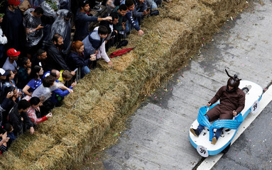 Competitor rides a home-made vehicle on a downhill track during the Red Bull Soapbox Race in Sao Paulo