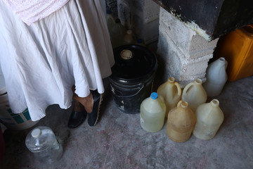 Containers are seen inside a store that sells gasoline on the black market in Port-au-Prince
