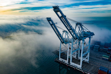 Port Freight Cranes with Fog Aerial Photo From Drone Long Beach