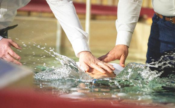 Close up of pastors hands who baptize man