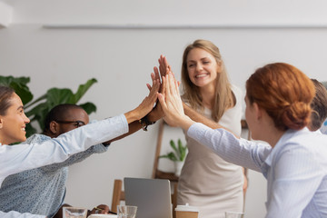 Reliable happy diverse business team people give high five together