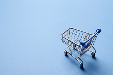 Shopping concept.  shopping cart on a blue background.