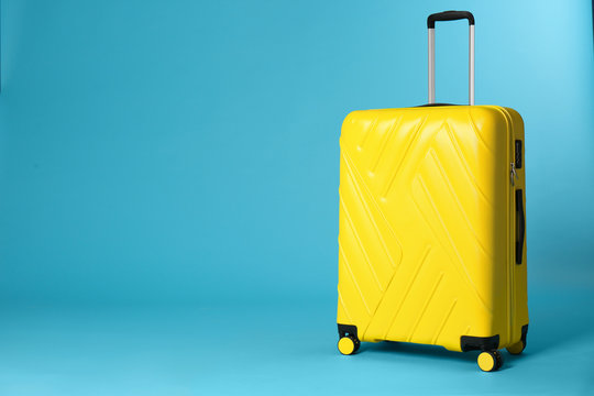 Stylish suitcase on color background. Space for text