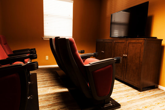 Small Home Theater Room With Cushioned Cinama Chairs