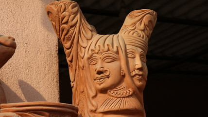 Claywork pots, bells, artwork at Pottery town, bangalore