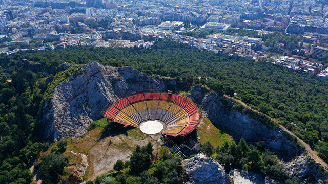 Aerial drone view from of open air theatre on top of Lycabettus hill with views of city of Athens, Greece