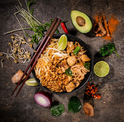Pad thay asian food background with various ingredients on rustic stone background , top view.