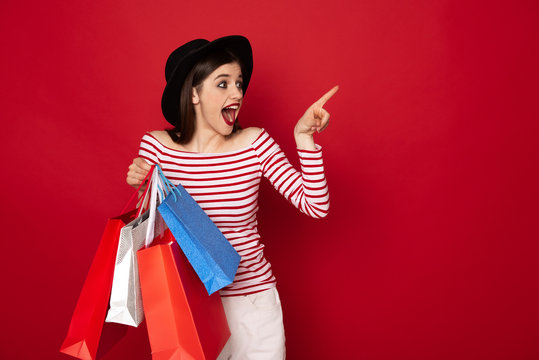 Happy excited lady with many shopping packs