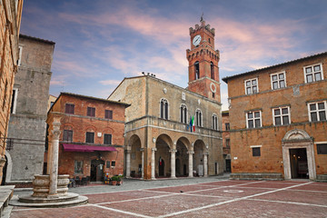 Pienza, Siena, Tuscany, Italy: the main square with the ancient city hall and the water well