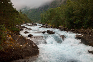 spellbinding landscape of Norwegian nature with high charming mountains and hills, wonderful rivers in which it is impossible not to fall in love