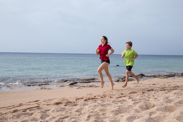 Two kids running together at morning exersises