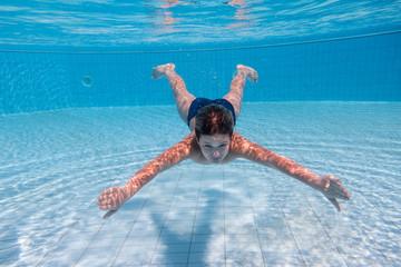 Boy dive in swimming pool