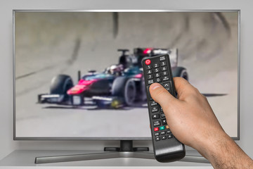 Formula F1 racing on TV and TV remote controller