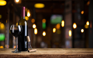 Expensive wine bottles collection and wooden barrel in the cellar, wine tasting and production concept