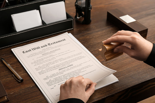 Female notary public working at table