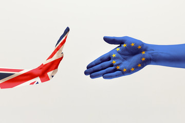 Misunderstandings and intense conversation. Male hands colored in United Kingdom and European Unity flags isolated on white studio background. Concept of political, economical, social, disagreement.