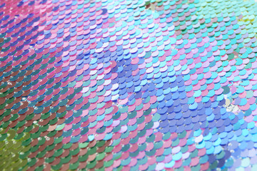 Bright iridescent sequins, closeup