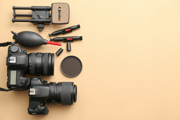 Modern equipment of professional photographer on color background Fototapete