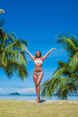 Woman with arms raised on vacation